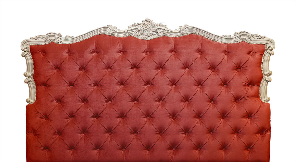 Red soft velvet fabric capitone bed headboard of Chesterfield style sofa isolated on white background, front view Pattern No People Design Indoors  Textured  White Background Leather Retro Styled Cut Out Luxury Wealth Red Studio Shot Textile Decoration Ornate Close-up Shape Textured Effect Capitone Headboard Bed Chesterfield Sofa Tufted Softness