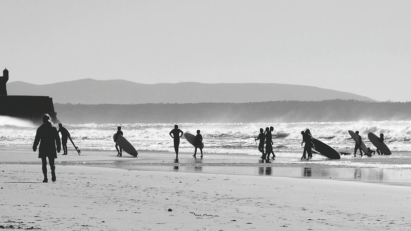 Surf's Up The Beach Life and the Surfers getting out of the Water Carcavelos Beach Lifestyles Horizon Over Water Leisure Activity Waves, Ocean, Nature Coastline Real People People Black And White Black & White Seascape Eyeem X Whitewall: Nature EyeEm X WhiteWall: Landscap