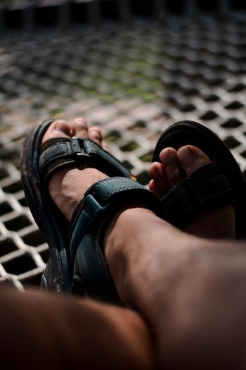 Low section of man wearing sandals