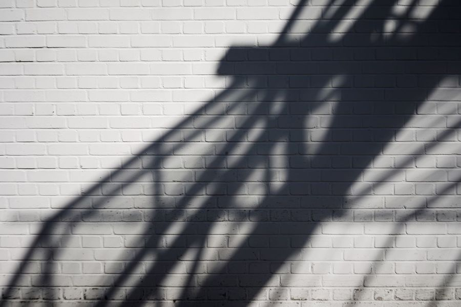 Shadow Sunlight Wall - Building Feature Day Pattern Focus On Shadow Brick No People Brick Wall Outdoors Architecture Wall Sunny Built Structure Street City High Angle View