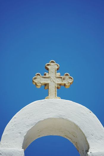 cross on top of a greek church Church Churches Cross Greek Orthodox Greek Orthodox Church Blue Sky Greece City Astrology Sign Blue Sculpture Cross Clear Sky Religion Grave Sky Memorial Place Of Burial Graveyard Cemetery Icon Cross Shape