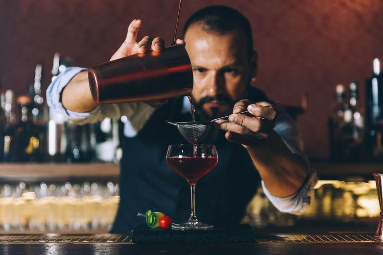Bartender preparing cocktail in bar
