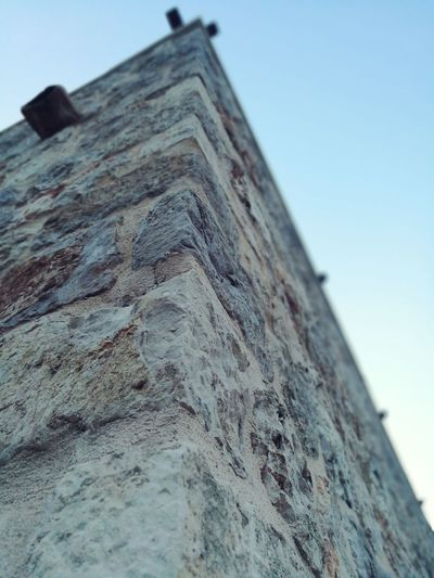 Evening Wall Walls Stone Wall Stonewall Lookingup Corner Corners Corners And Edges Cornerstone No People Outdoors Outdoor Photography Outdoors Photograpghy  Outdoor Pictures Outdoors Photography Clear Sky Blue Sky Close-up Architecture