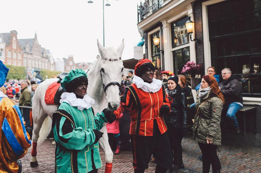Celebration City Crowd Day Enjoyment Festival Festival Season Grote Markt Horse Large Group Of People Lifestyles Netherlands Outdoors Parade People Saint Nicholas Sint-Nicolaas Sinterklaas Togetherness Warm Clothing Watching Women Zwarte Piet