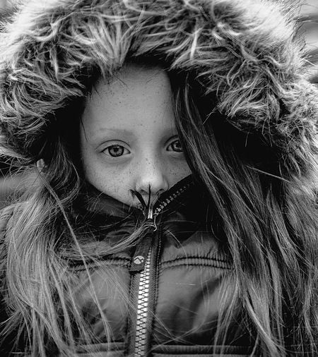 Close-up portrait of girl wearing warm clothing during winter