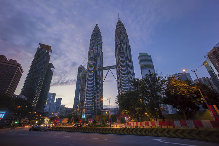 Blue hour golden sunrise at Kuala Lumpur city busy junction Architecture Building Exterior Business Business Finance And Industry City City Life Cityscape Corporate Business Downtown District Illuminated Junction Modern Night Office Building Exterior Outdoors Road Sky Skyscraper Sunset Tower Travel Travel Destinations Urban Skyline