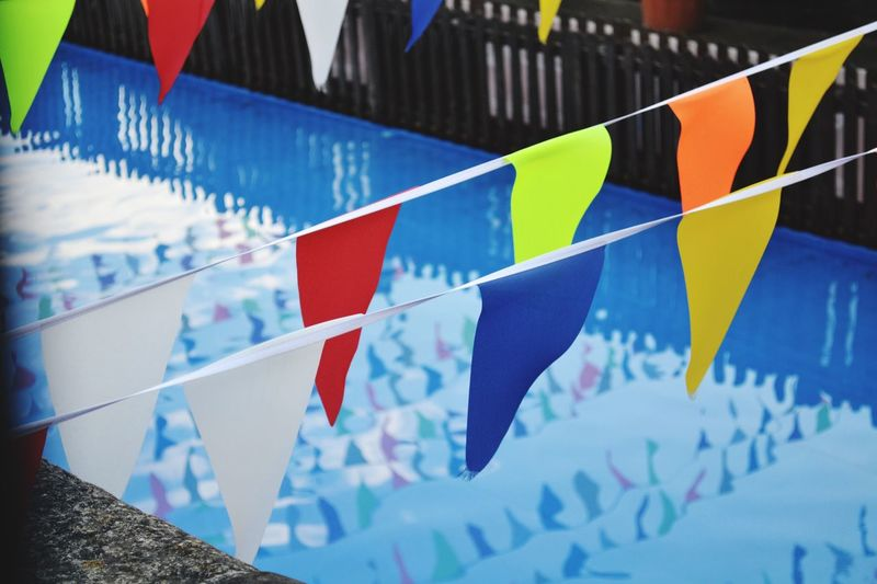 Multi Colored Blue Celebration Bunting No People Flag Day Outdoors Close-up Paper Water Wales
