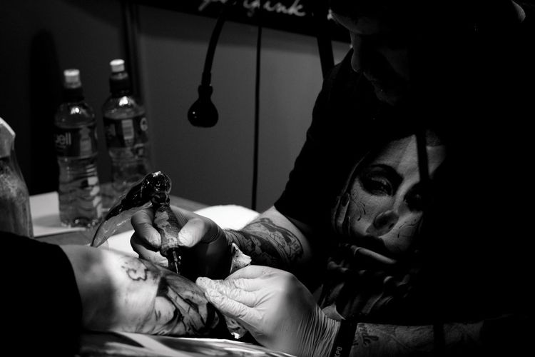 Picture taken during 1st Cork Tattoo Expo Arm Tattoo Arm Tattoo Done Black And White Hands Hands At Work Lifestyles Tatto Convention Tattoo Tattoo Art Tattoo Artist Tattoo Design Tattoo Machine Tattoo Obsession Work The Photojournalist - 2016 EyeEm Awards