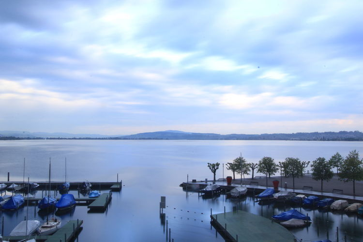 Zürichsee Yacht Peace Marina Lachen Small Boat Tranquil Scene Switzerland Beauty Lake View Vacations Travel Destinations Tranquility Harbor Boat Horizon Over Water Water Reflection Sky Village Morning View Morning Glory Scenics Reflection Blue