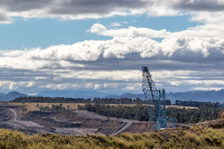 Coal mine digger and pit beneath cloudy sky Australia Australian Cloudy Conveyor Belt Hunter Valley Industrial Industry Power Architecture Black Cloud - Sky Clouds Coal Day Digger Electricity  Energy Mine Mining Nature No People Outdoors Sky Sky Stockpile