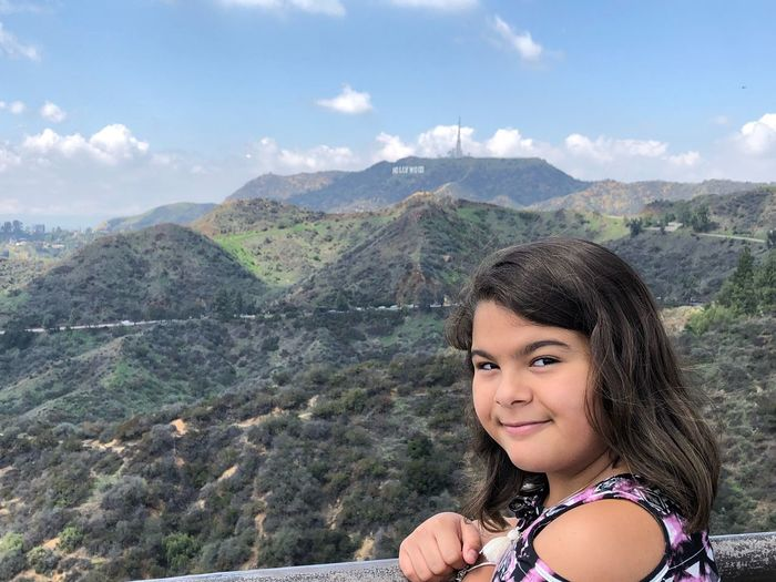 Portrait of girl against mountains