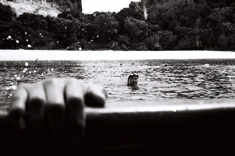 Men swimming in water