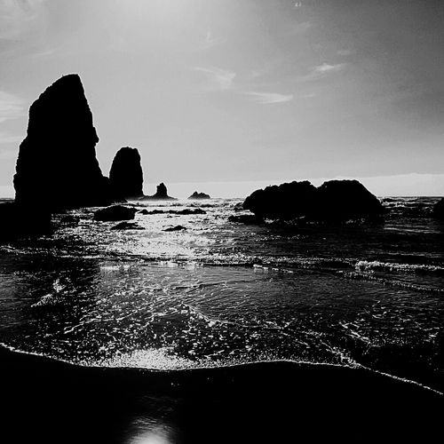 Sea Rock - Object Rock Formation Water Nature Tranquility Scenics Beauty In Nature Horizon Over Water Silhouette No People Outdoors Beach Sky Day Clear Sky Cannon Beach, OR