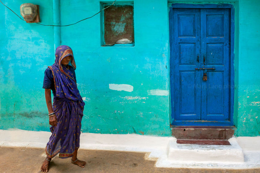 Streets of Khajuraho, India Atmosphere Blue Built Structure Closed Color Composition Day Door Female Geometry India Indian Khajuraho Madhyapradesh Mood The Street Photographer - 2016 EyeEm Awards Old One Person People Poverty Sari Street Streetphotography Travel Woman