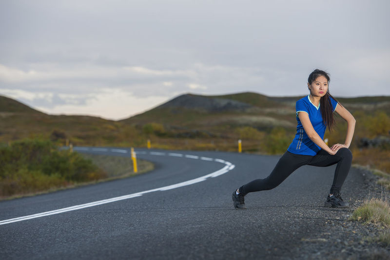 Full length of woman on road against mountains