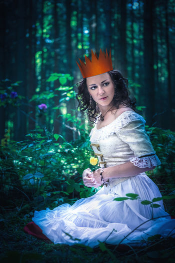 an outdoor portrait of a young wonan in the fairytale style Art, Attractive, Beautiful, Beauty, Costume, Creative, Dress, Elf, Enchanted, Fairy, Fairytale, Fantasy, Fashion, Female, Folklore, Forest, Girl, Girls, Goddess, Indigenous, Magic, Magical, Myth, Mythology, Nature, Nymph, Outdoors, People, Person, Rainfor Tree One Person Plant Women Hair Hairstyle Young Adult Outdoors Beautiful Woman