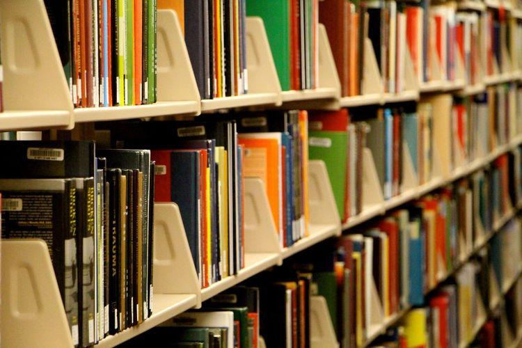 High Angle View Of Book On Shelf