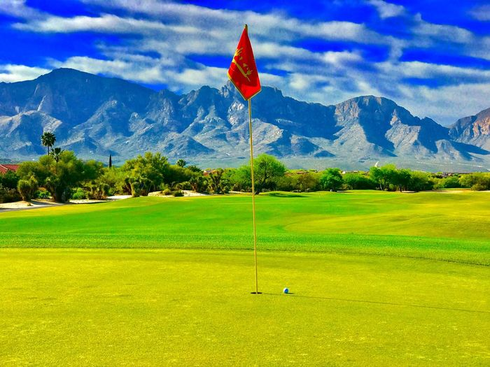 Golf Golf Course Golf Flag Flag Grass Green - Golf Course Green Color Mountain Sky Nature Tree Beauty In Nature Growth Scenics Outdoors Day Landscape No People Sport Golfer Check This Out EyeEmNewHere EyeEm Gallery Mountain Range Competitive Sport