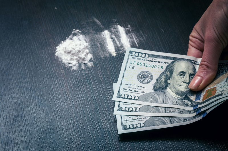 Cocaine Sniffing Money Currency Hand Finance Paper Currency Human Hand Human Body Part Wealth Business One Person Body Part Indoors  Real People Close-up Holding Social Issues Finger Men Dollar Sign Human Limb