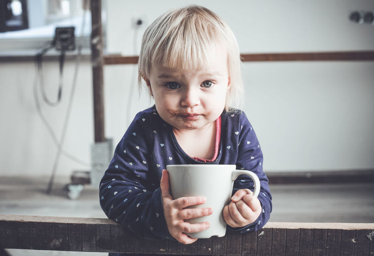 Portrait Of Girl Drinking Hot Chocolate From Mug