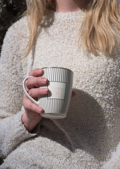 Drink One Person Holding Cup Refreshment Food And Drink Mug Hair Drinking Adult Sweater Women Coffee Cup Blond Hair Hot Drink Young Adult Hand Hairstyle Midsection White Fingers