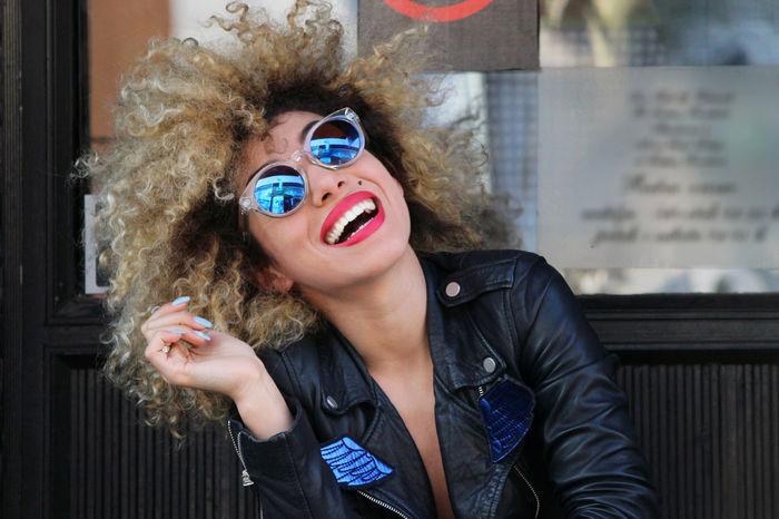 Portrait of happy woman in sunglasses