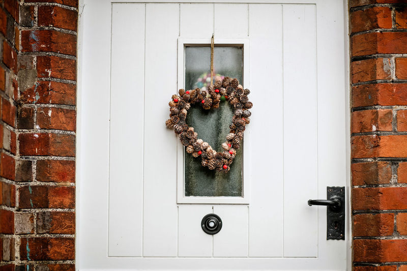 Christmas decoration Christmas Decoration Christmas Decorations Christmas Alresford Alresford, UK Wreath Christmas Wreath Door White Door Brick Wall Architecture Entrance Brick Building Exterior No People Decoration Wall Day Front Door Outdoors House