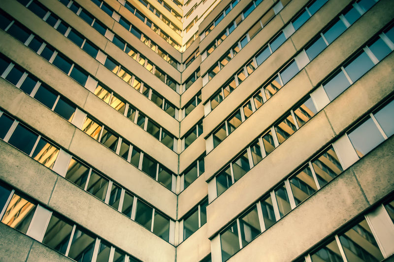 Lines Apartment Architectural Feature Architecture Backgrounds Building Building Exterior Built Structure Ceiling City Day Full Frame Low Angle View Modern No People Office Office Building Exterior Outdoors Pattern Railing Repetition Symmetrical Symmetry Window