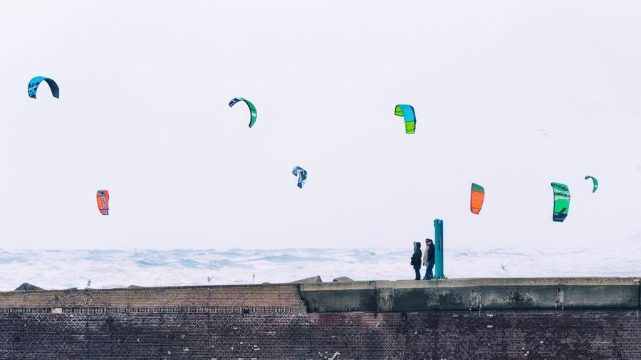 EyeEm Selects Leisure Activity Mid-air Kite - Toy Lifestyles Outdoors Extreme Sports Flying Multi Colored Sea Adventure Full Length Sky Kitesurfing Pier Scheveningen  Nikon Nikonphotography Landscape Skyline Skyscape Sea And Sky Seascape Colourful