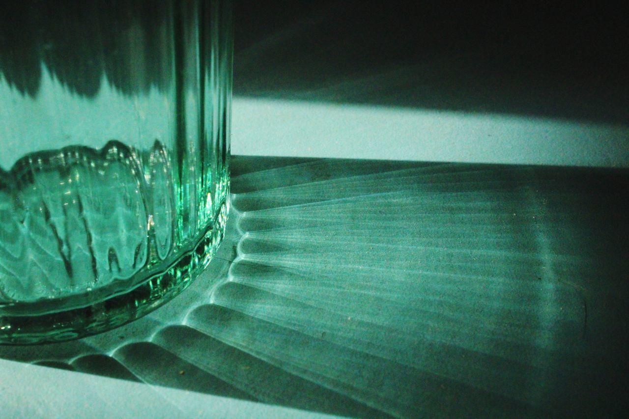 HIGH ANGLE VIEW OF GLASS TABLE