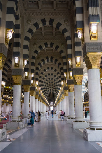 MEDINA, SAUDI ARABIA - 15TH NOV 2017; Internal view of Mosque Al-Nabawi in Medina, Saudi Arabia. It is the second-holiest site in Islam and the mosque was built by Prophet Muhammad in 622 Caligraphy Faith Medina Al Munawarah Nabawi Mosque Pray Arabic Arch Architecture Built Structure Ceiling City Day Illuminated Indoors  Muslim Pilgrim Pillar Tourism Travel Travel Destinations