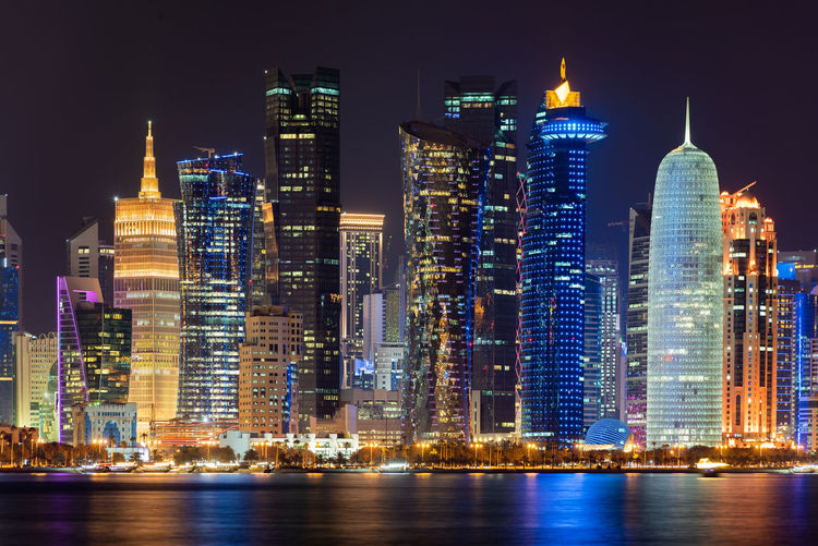 Doha, Qatar Building Exterior Architecture Night Built Structure Building Office Building Exterior Illuminated City Skyscraper Water Waterfront Landscape Tall - High Cityscape Modern Travel Destinations Urban Skyline Downtown District Sky No People Outdoors Financial District  Luxury Doha Qatar Middle East