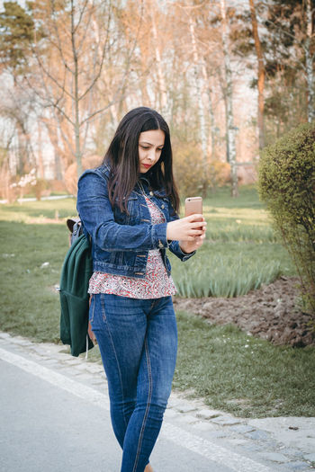 Woman behind the lens Mobile Phone Nature Taking Photos Trees Woman Beautiful Woman Casual Clothing Clothing Day Denim Hair IPhone Jeans Long Hair Mobile Phone One Person Outdoors Park Photographer Smartphonephotography Standing Technology Tree Wireless Technology Young Adult