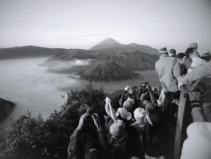 Panoramic view of sea against mountain range
