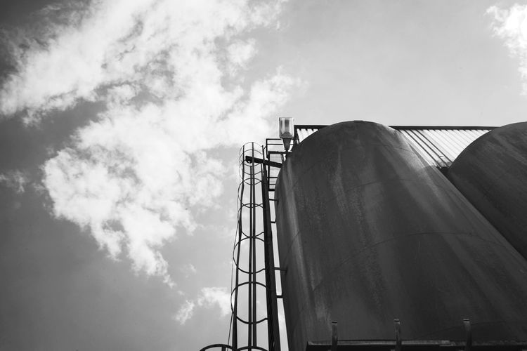 Industry Low Angle View Factory Sky Storage Tank Built Structure Cloud - Sky Day Silo Architecture Fuel And Power Generation Outdoors No People Power Station