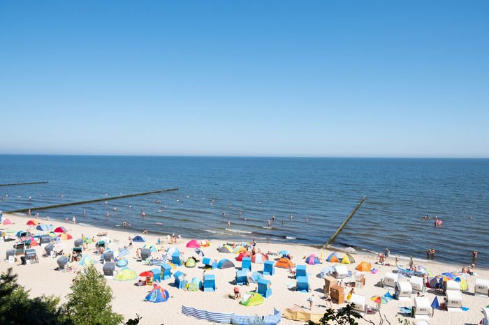 Beach Blue Clear Sky Copy Space Crowd Day Group Of People High Angle View Holiday Horizon Horizon Over Water Koserow Land Large Group Of People Nature Outdoors Scenics - Nature Sea Sky Water