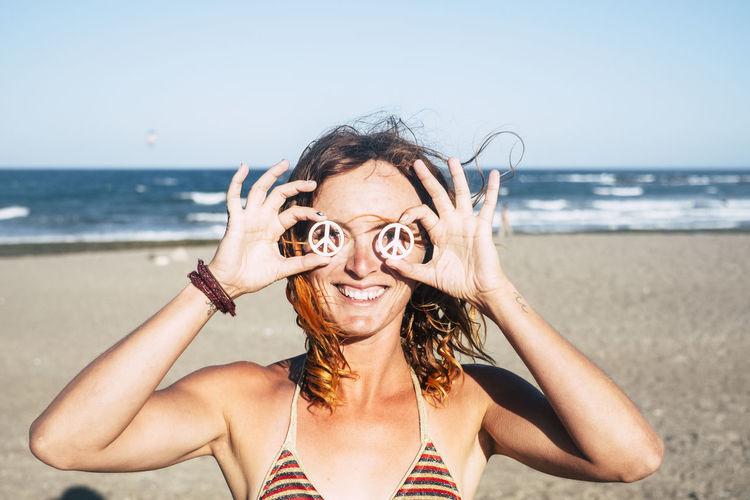 Portrait of woman wearing hat on beach
