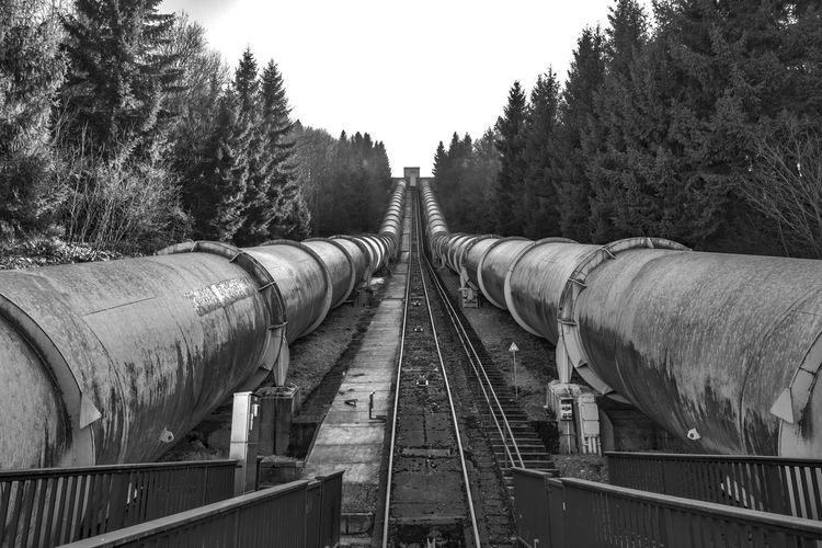 Hydroelectric power station in Harz mountains, Germany. Architecture Water Energy Black And White Blackandwhite Blackandwhite Photography Bnw Bnw_friday_eyeemchallenge Business Connection Day Diminishing Perspective Direction Freight Transportation Harz Hydroelectric Power Long Metal Nature No People Outdoors Sky The Way Forward Transportation Tubes vanishing point