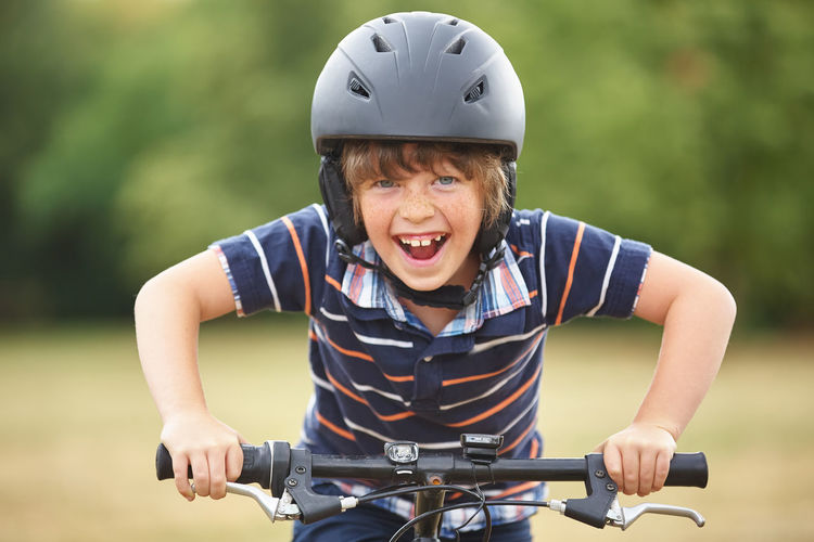 Portrait Of Smiling Boy Riding Bicycle