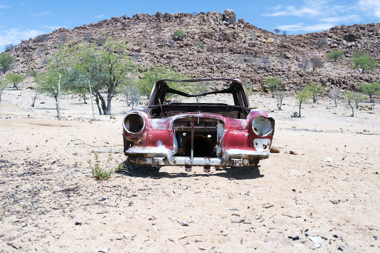 A wrecked junk car in the desert Wrecked Car Transportation Mode Of Transportation Land Vehicle Land Abandoned Day Obsolete Damaged Nature Motor Vehicle Car Sunlight Run-down Old Field No People Decline Sky Deterioration Bad Condition Outdoors Ruined Africa Kenya