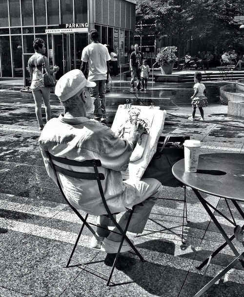 "I couldn't pass by this ""artist"" in his element! People Watching Escaping Monochrome Cincinnati First Eyeem Photo Madlovphotography Madlovphotos RePicture Ageing"