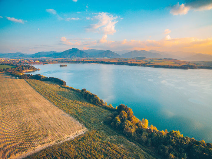 Aerial view of Liptovska Mara lake with the Tatra Mountains in the background. Autumn sunset. Drone  Liptovska Mara Aerial Beauty In Nature Day Dji Drone Environment Lake Land Landscape Mountain Nature No People Outdoors Scenics - Nature Sky Tranquil Scene Tranquility Water The Great Outdoors - 2018 EyeEm Awards