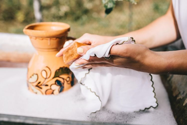 Female hands wash linen with soap