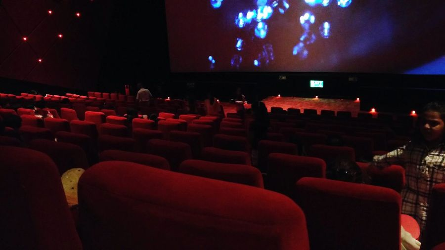 Movie time Arts Culture And Entertainment Empty Seat In A Row Chair Movie Theater Absence Illuminated Red Auditorium Large Group Of Objects Indoors  Repetition Person Theater Stage Theater Event Church Arrangement Man Made Object Multi Colored EyeEm Nature Lover EyeEm Gallery Building ExteriorAbundance