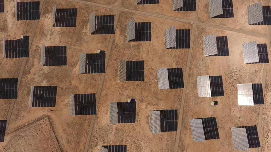 Aerial View Of Solar Panels In Desert