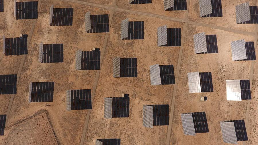 Aerial view of solar panels in desert
