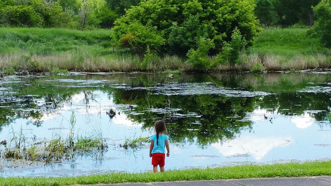 My daughter at lake Girl At Lake Lake Water Green Green Green!  Cloud_collection  United States Travel Photography Nature Photography Sky_collection Landscape_Collection Nature_collection Beautiful Nature Nebraska MidWest Clouds And Sky Blue Sky White Clouds Blue Sky Grass Trees Water Reflections Water_collection Landscape Green EyeEm Nature Lover