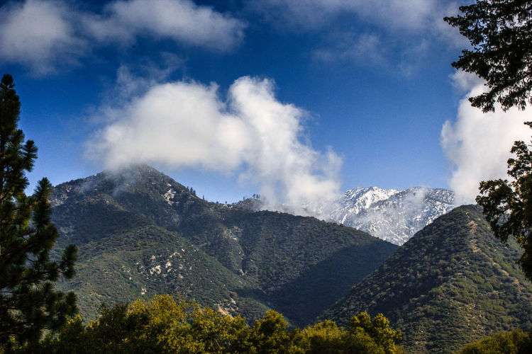 Mountain landscape with cloudy blue sky Beauty In Nature California Clouds And Sky Day High Landscape Mount Baldy Mountain Nature No People Outdoors Peak Range Scenery Sky Snowcapped Mountain