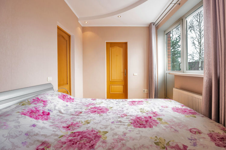 Pink flowers on bed of house