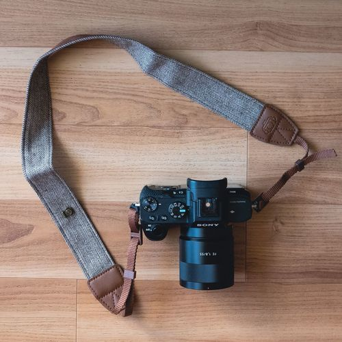 My new camera strap. Wood - Material Table Directly Above High Angle View Hardwood Floor Old-fashioned Camera - Photographic Equipment Indoors  Wood Grain No People Vintage Accessory Strap Camera Sony SONY A7ii